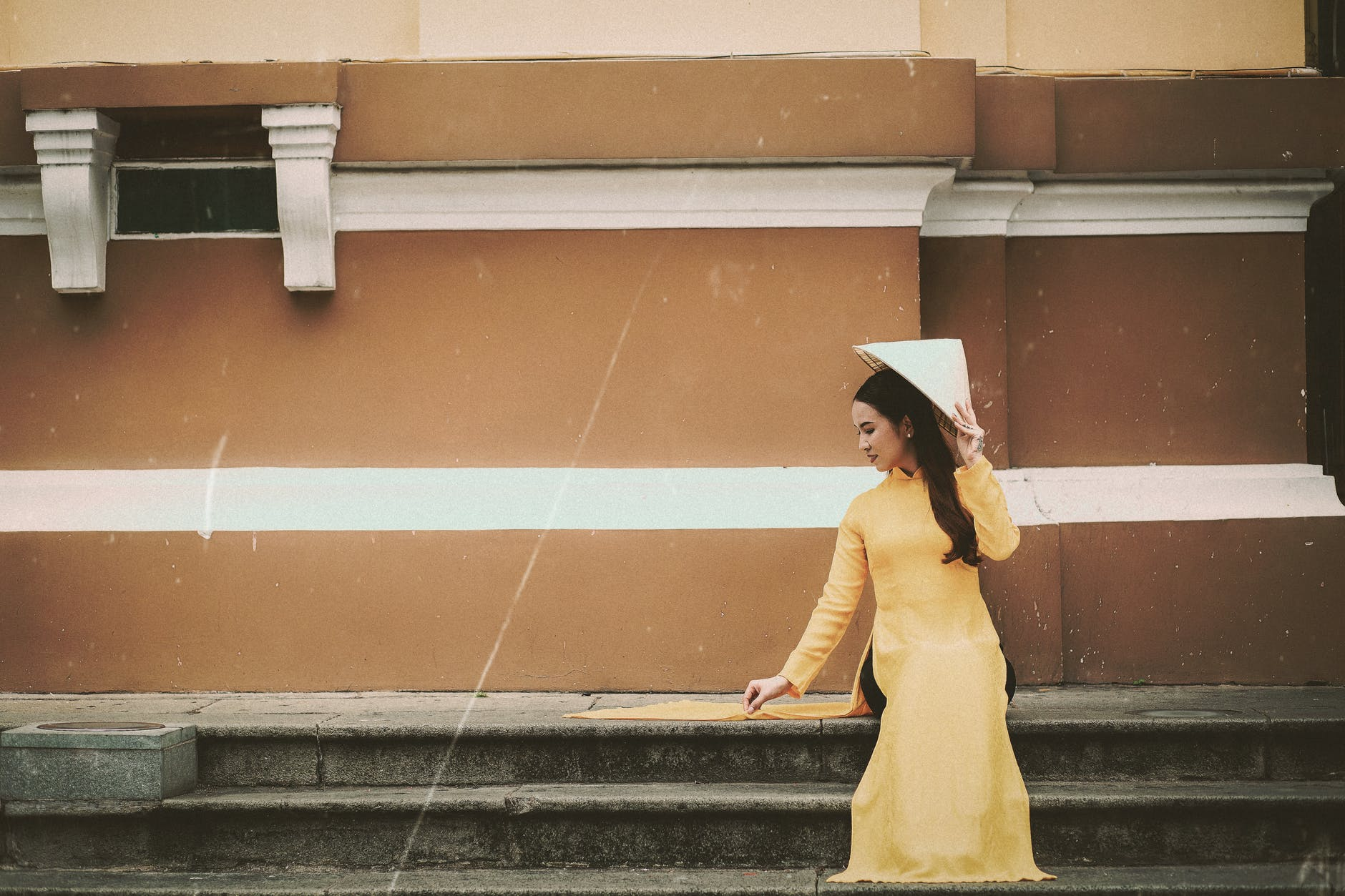 woman in yellow long sleeved traditional wear